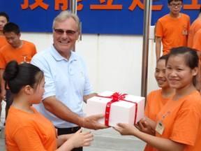 Ritz Carlton Sanya GM visit Bainian School